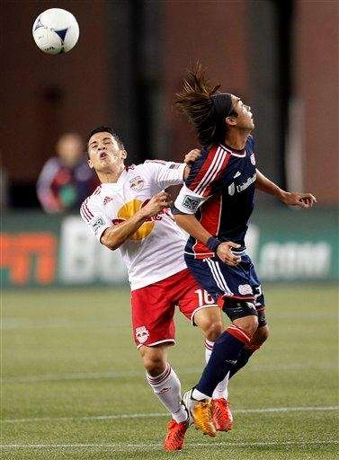 Connor Lade of the Red Bulls, left, heads