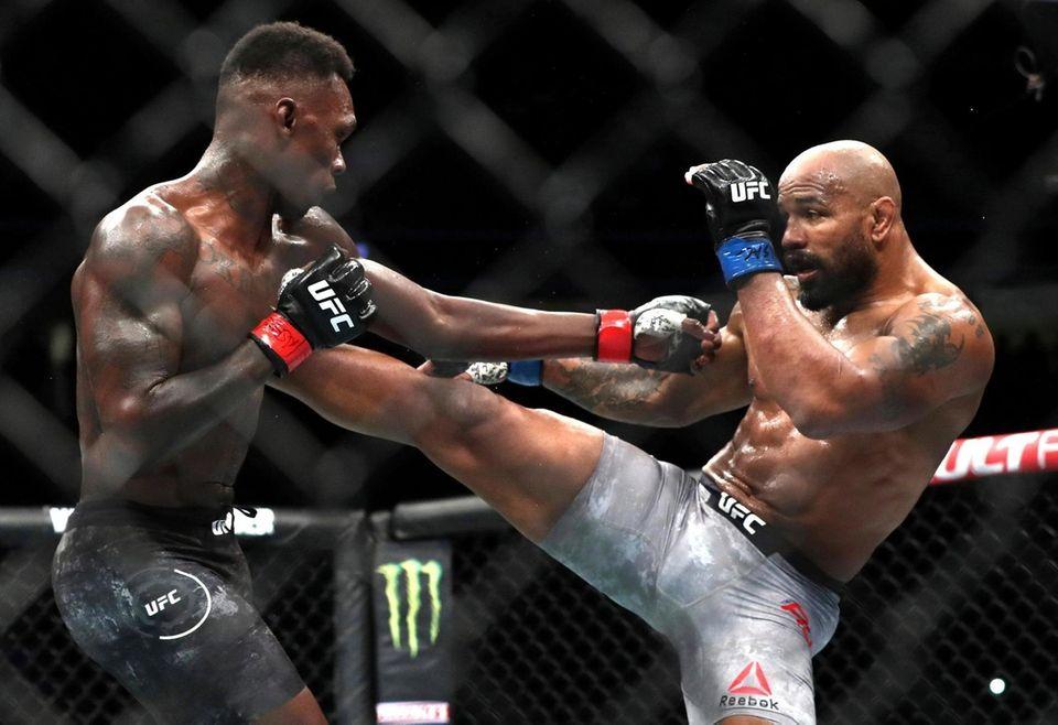 Yoel Romero of Cuba kicks UFC middleweight champion