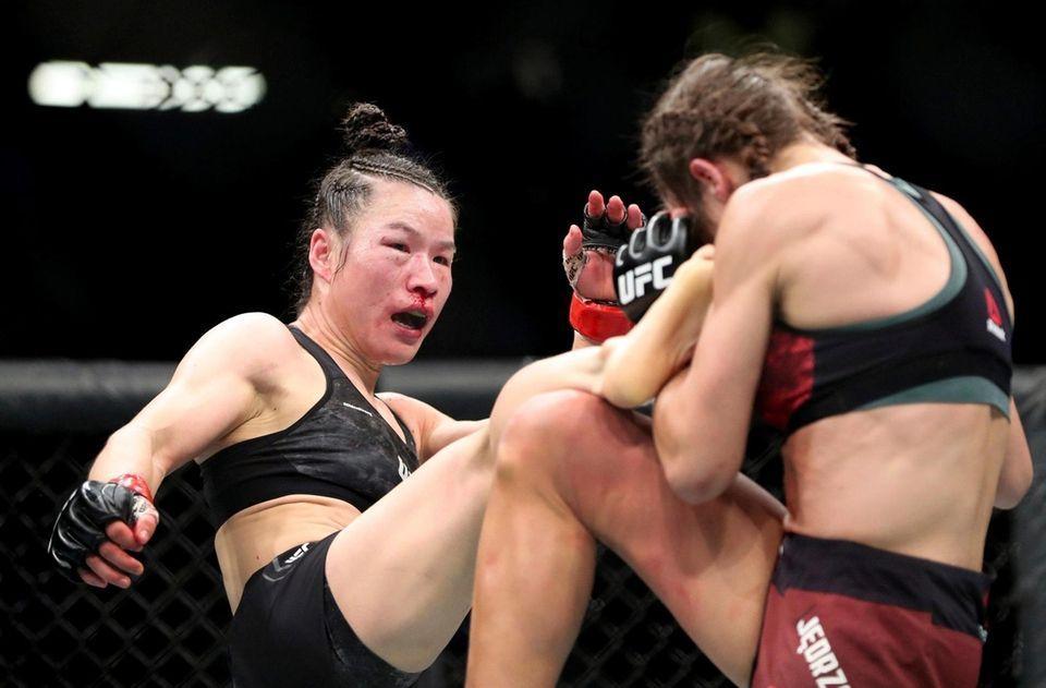 UFC women's strawweight champion Weili Zhang, left, of