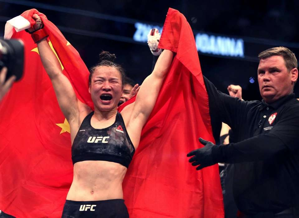 Zhang Weili celebrates her win by decision over