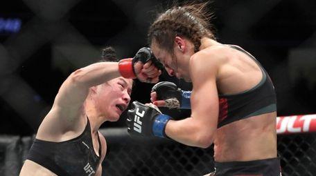 UFC women's strawweight champion Zhang Weili, left, of