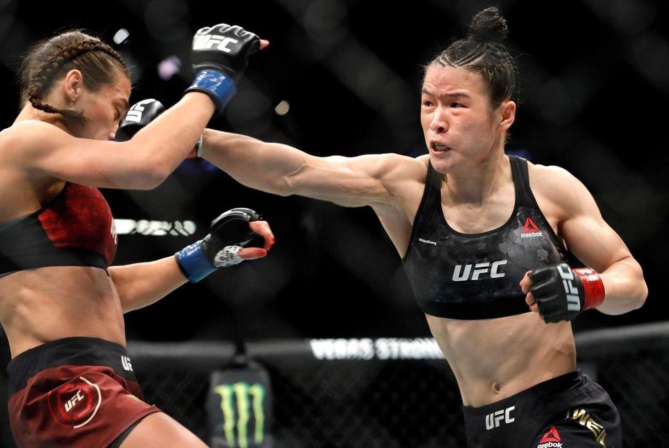 UFC women's strawweight champion Weili Zhang, right, of