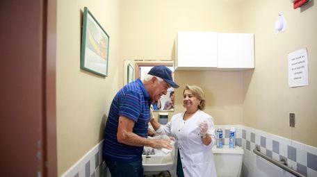 In this March 4 photo, nursing assistant Natasha