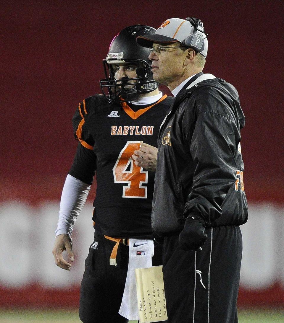 Babylon head coach Rick Punzone directs his quarterback