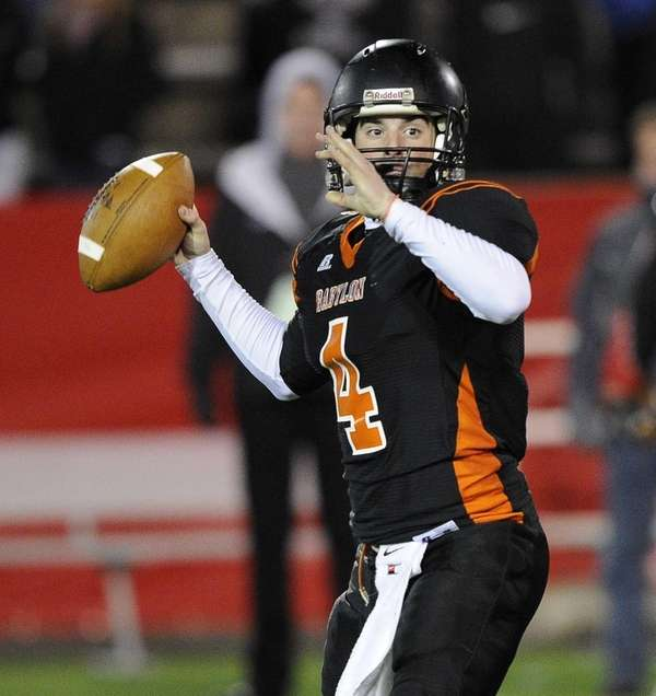 Babylon quarterback Nick Santorelli looks for an open