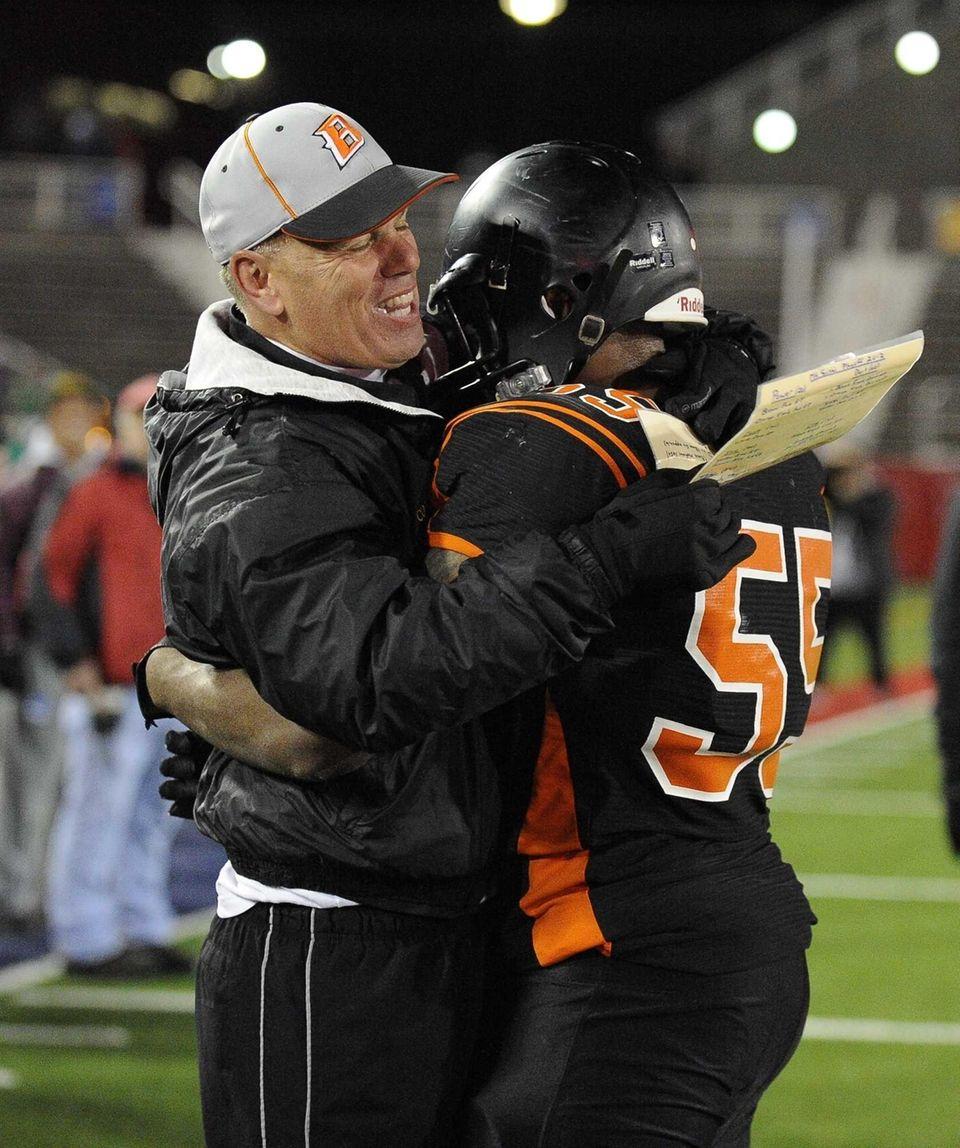 Babylon head coach Rick Punzone celebrates with Andrew