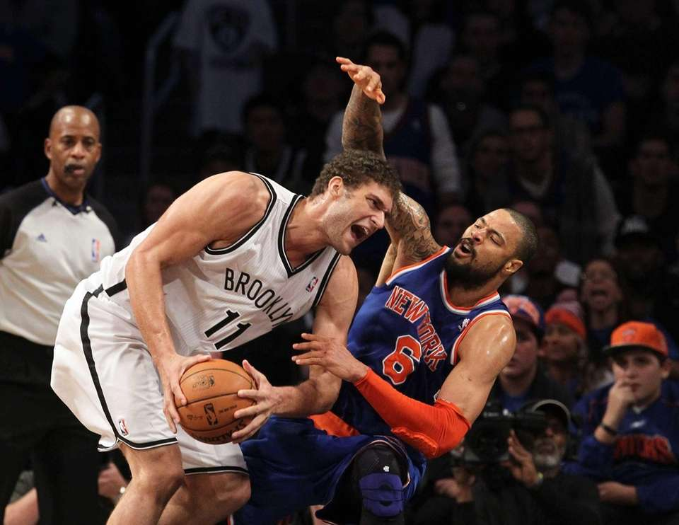 Brook Lopez of the Brooklyn Nets commits an