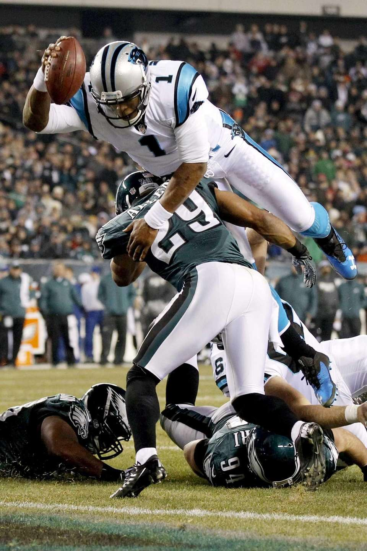 Carolina Panthers quarterback Cam Newton hurdles Philadelphia Eagles