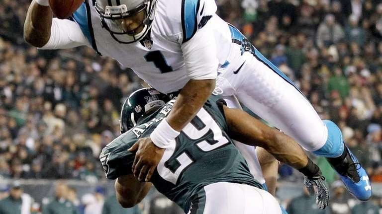 Carolina Panthers quarterback Cam Newton hurdles Philadelphia Eagles