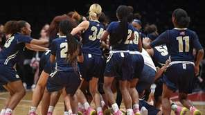 Baldwin girls basketball players celebrate after their 60-52
