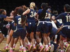 Baldwin girls basketball players celebrate after their 60-52