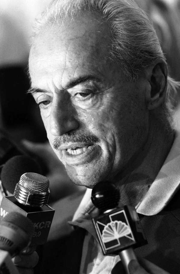 Marvin Miller talks to reporters at the Doral