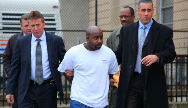 Wilfred Labossiere, 31, of Far Rockaway, is escorted