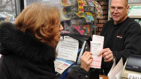 Rita Mostaccio, of Islip Terrace, purchases a Powerball