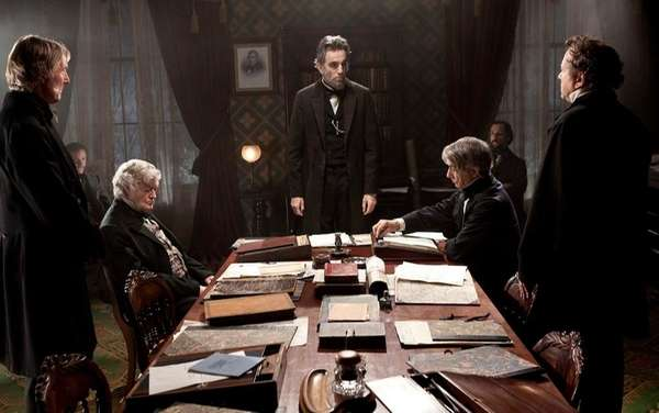 Daniel Day-Lewis, center rear, as Abraham Lincoln, in