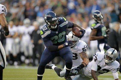 Seattle Seahawks' Kregg Lumpkin runs in the first