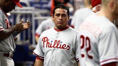 Philadelphia Phillies catcher Carlos Ruiz stands in the