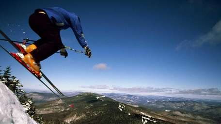 A skier goes airborne near Cascade Trail on