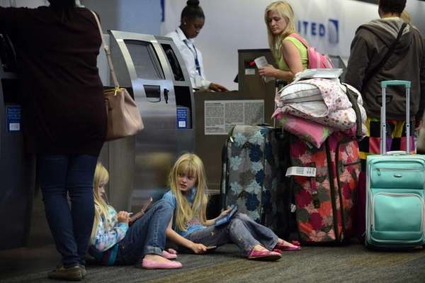 Travelers at a California airport try to book
