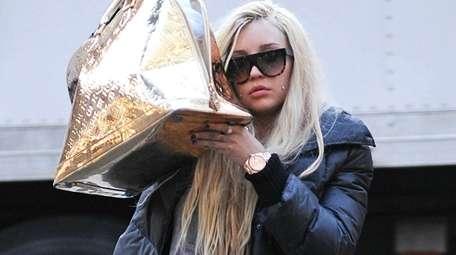 Amanda Bynes out and about in a file