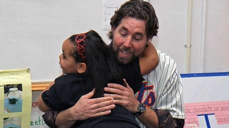 R.A. Dickey gets a surprise hug from a