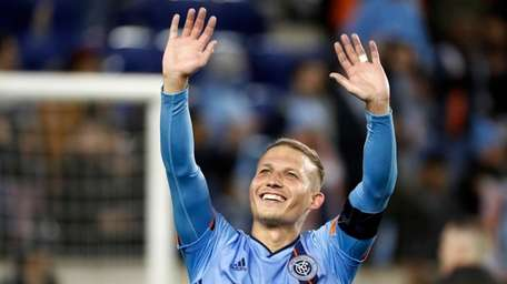 New York City FC midfielder Alexander Ring waves