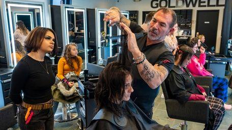 Apprentice stylist Bianca Rivera, 20, watches as salon