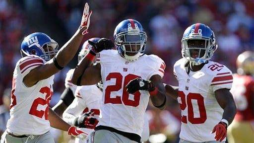 New York Giants free safety Antrel Rolle, center,