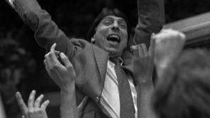 North Carolina State coach Jim Valvano waves the