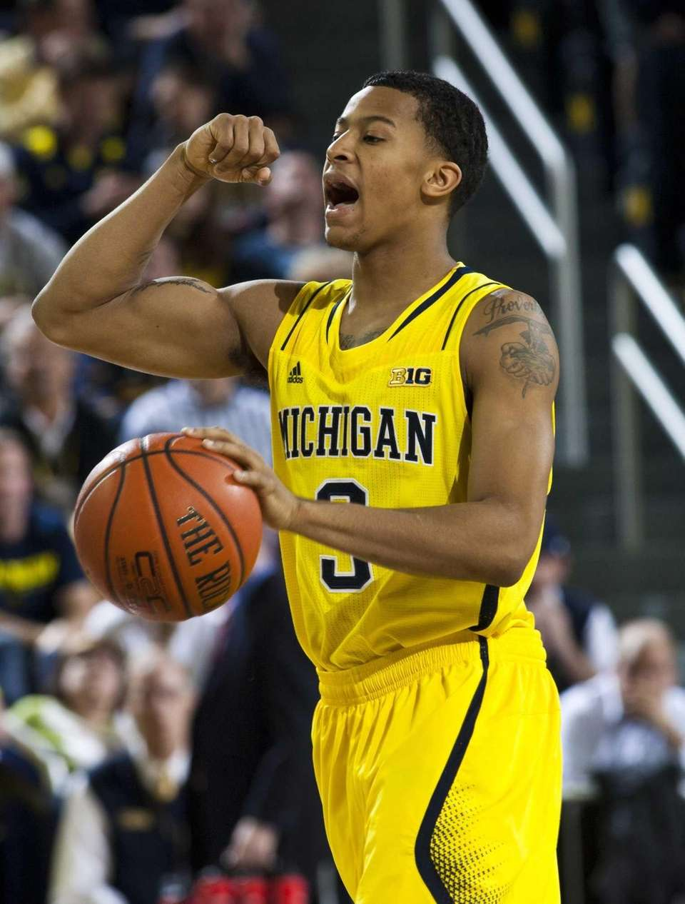 Michigan guard Trey Burke calls out a play