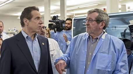 Gov. Andrew M. Cuomo and Michael J. Dowling,