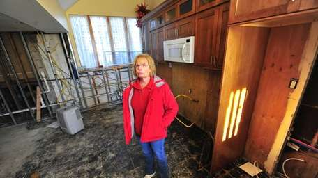Gale Bartolo stands in what was once her