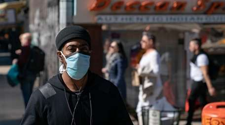 A man wears a face mask in New