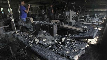 A man takes photographs Monday inside a garment-factory