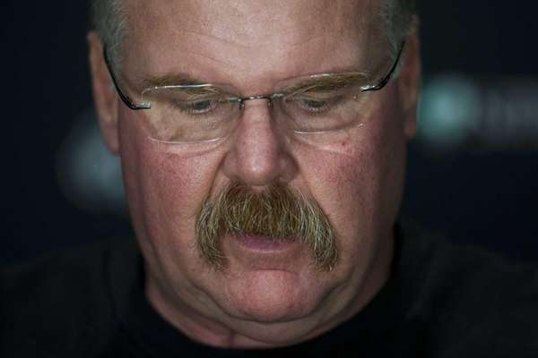 Philadelphia Eagles coach Andy Reid looks down and
