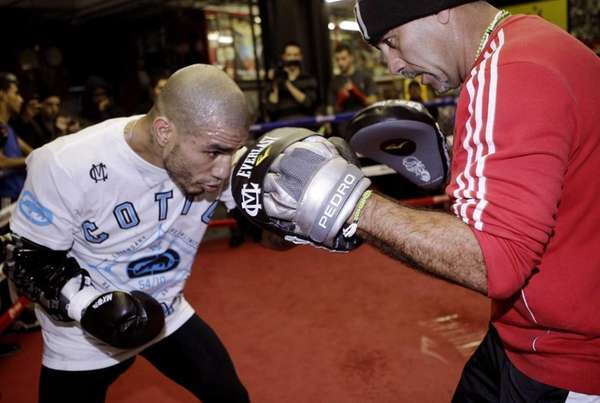 Miguel Cotto, left, of Puerto Rico, spars with