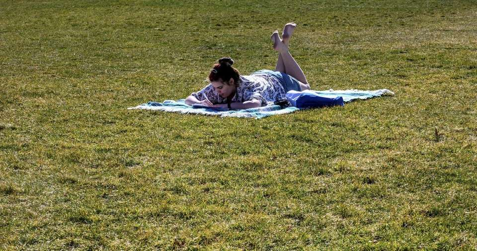 Abigail Houck takes advantage of today's mild weather