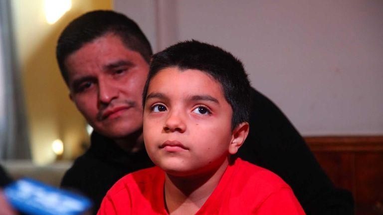 Josue Molina, 7, speaks in Garden City Park