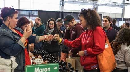 People taste testing at the Hot Sauce Expo