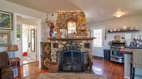 There is a stone-faced wood-burning fireplace in the