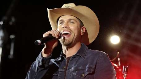 Dustin Lynch performs at a pre-CMA party on