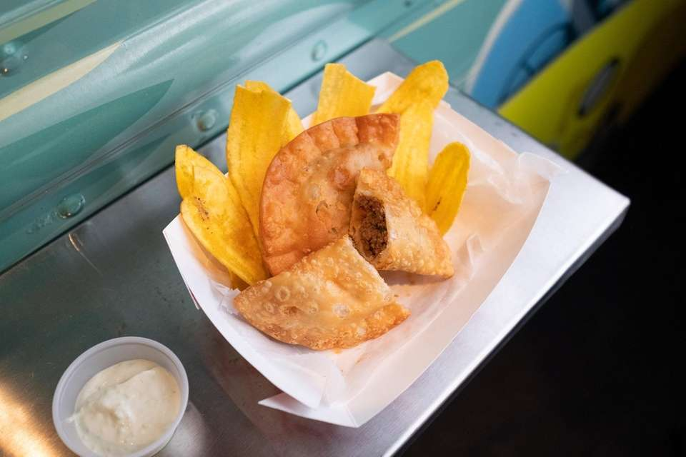 Ground beef empanadas are served with crispy fried