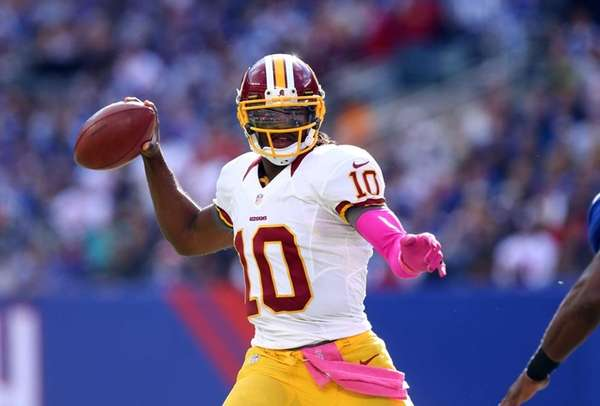 Robert Griffin III of the Washington Redskins throws