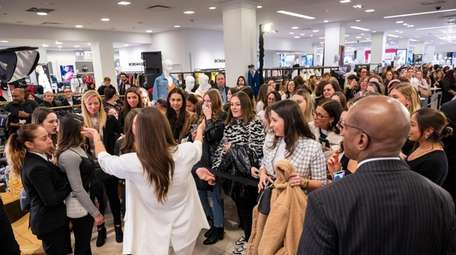 Danielle Bernstein greets fans as she debuts her