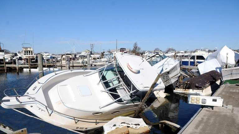 Boats, damaged by superstorm Sandy, await salvage at