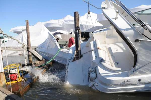 Boats are salvaged at the Anchorage Marina in