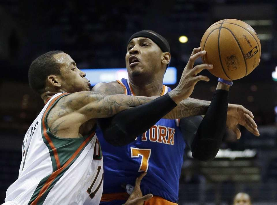 Milwaukee Bucks guard Monta Ellis fouls Carmelo Anthony