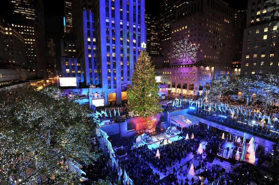 The 80-foot-tall Rockefeller Center Christmas Tree is lit