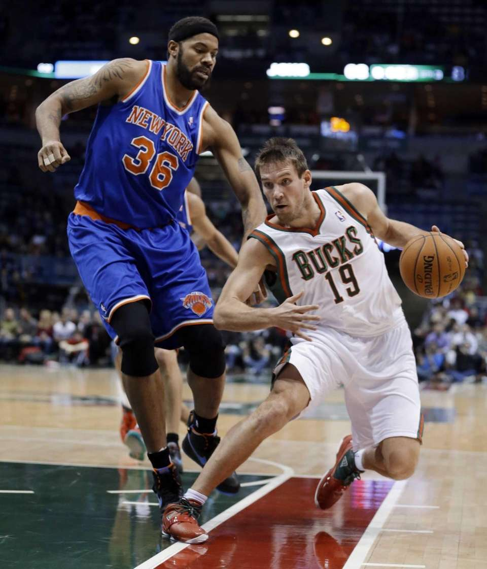The Milwaukee Bucks' Beno Udrih (19) tries to