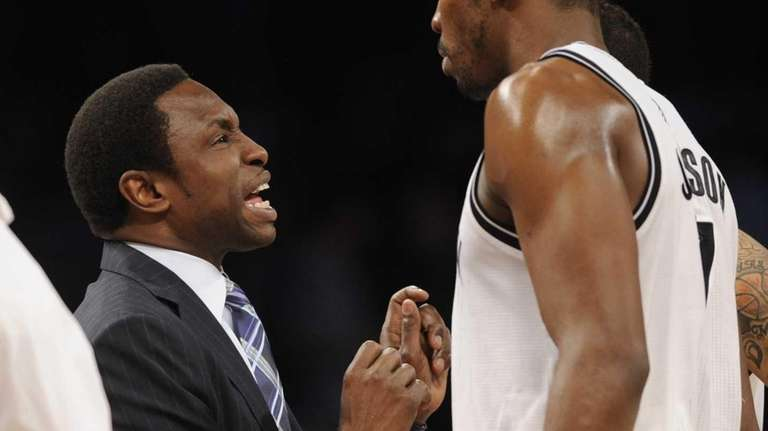 Avery Johnson, left, talks to Joe Johnson in